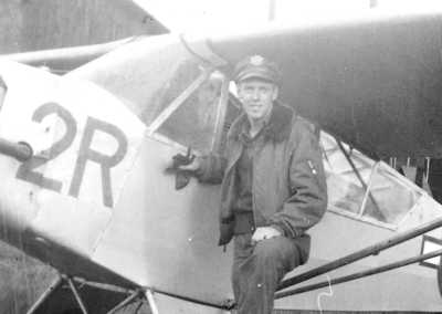 Jim Helinger with his L-5 Stinson Spotter Plane